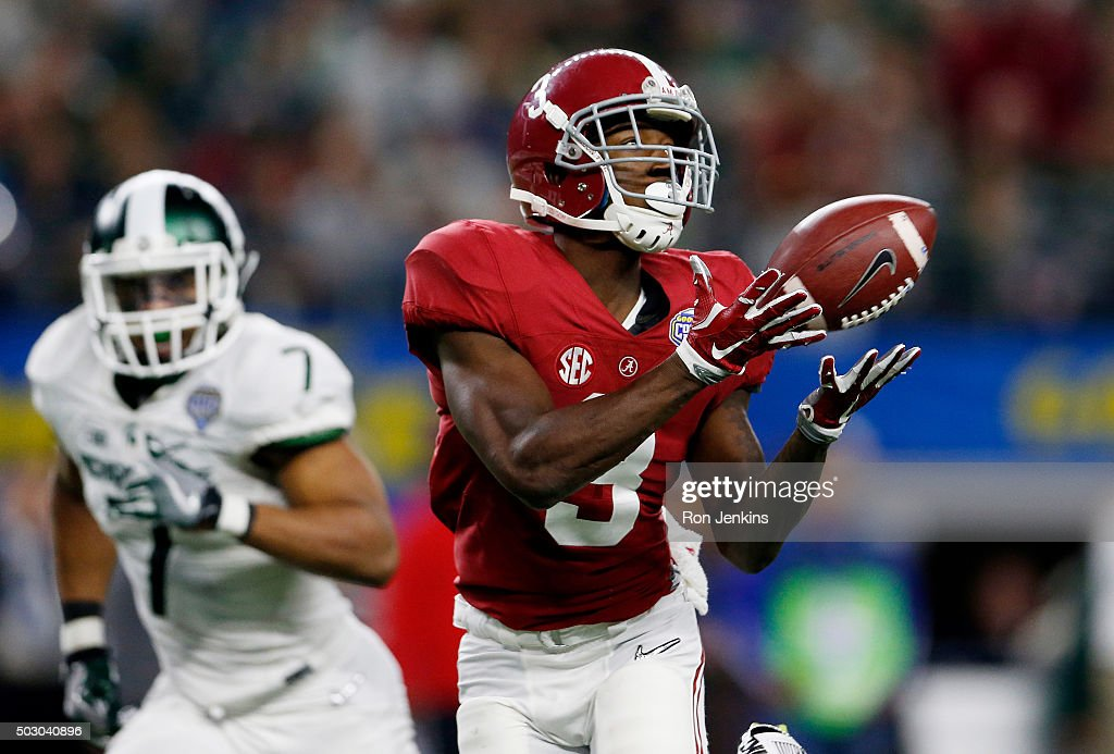 Calvin Ridley #3 of the Alabama Crimson Tide completes a 50 yard touchdown pass in the third quarter against the Michigan State Spartans during the Goodyear Cotton Bowl at AT&T Stadium on December 31, 2015 in Arlington, Texas.