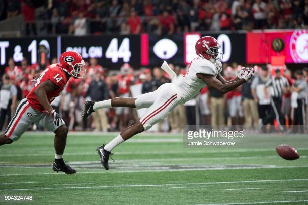 Calvin Ridley of the Alabama Crimson Tide dives for an incomplete pass against the Georgia Bulldogs during the College Football Playoff National...