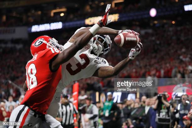 Calvin Ridley of the Alabama Crimson Tide fails to make a catch against Deandre Baker of the Georgia Bulldogs during the second half in the CFP...