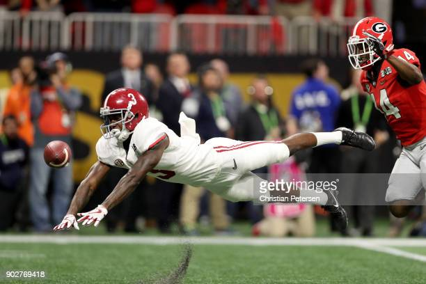 Calvin Ridley of the Alabama Crimson Tide fails to pull in a catch against Malkom Parrish of the Georgia Bulldogs during the third quarter in the CFP...
