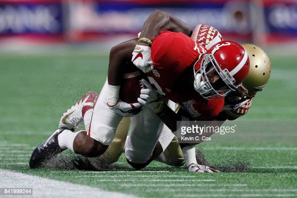 Calvin Ridley of the Alabama Crimson Tide is tackled after a catch against the Florida State Seminoles in their game at MercedesBenz Stadium on...