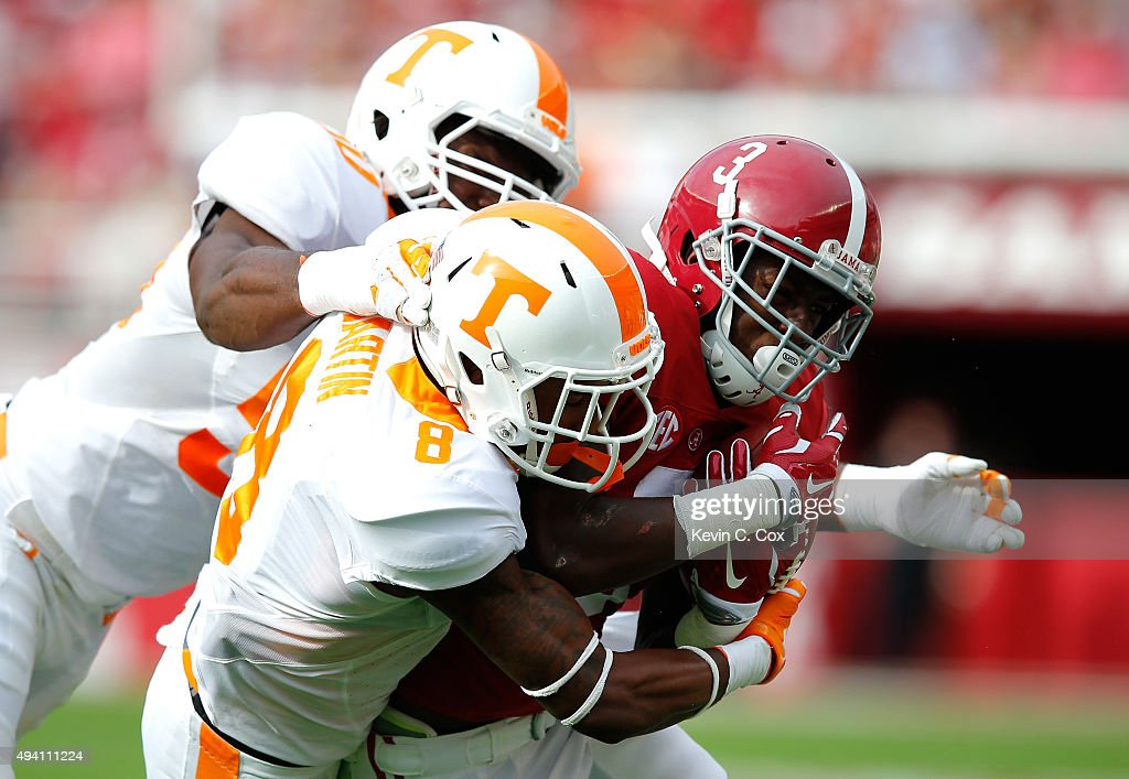 Calvin Ridley #3 of the Alabama Crimson Tide is tackled by Justin Martin #8 and Corey Vereen #50 of the Tennessee Volunteers at Bryant-Denny Stadium on October 24, 2015 in Tuscaloosa, Alabama.