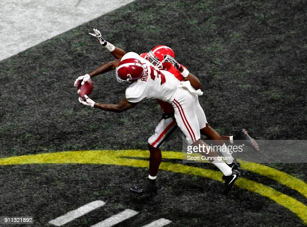 Calvin Ridley of the Alabama Crimson Tide is unable to make a catch in the end zone against Deandre Baker of the Georgia Bulldogs in the CFP National...