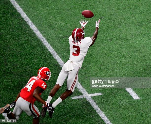 Calvin Ridley of the Alabama Crimson Tide is unable to make a diving catch against the Georgia Bulldogs in the CFP National Championship presented by...