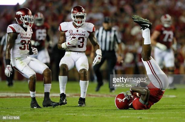 Calvin Ridley of the Alabama Crimson Tide pulls in this reception against Kevin Richardson II and Dre Greenlaw of the Arkansas Razorbacks at...