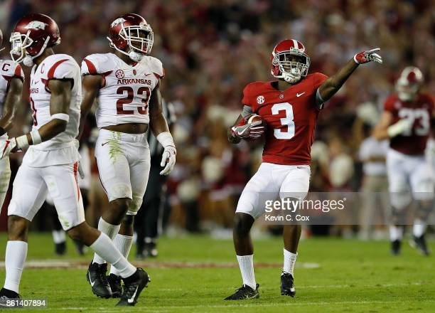 Calvin Ridley of the Alabama Crimson Tide reacts after pulling in this reception for a first down against Santos Ramirez and Dre Greenlaw of the...