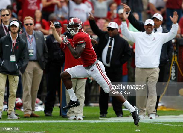 Calvin Ridley of the Alabama Crimson Tide runs this reception in for a touchdown against the Mercer Bears at BryantDenny Stadium on November 18 2017...