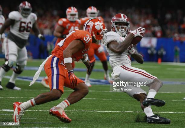 Calvin Ridley of the Alabama Crimson Tide runs wth the ball as Ryan Carter of the Clemson Tigers defends in the second half of the AllState Sugar...