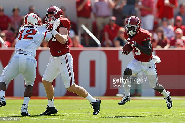 Calvin Ridley of the Alabama Crimson Tide rushes against the Western Kentucky Hilltoppers at BryantDenny Stadium on September 10 2016 in Tuscaloosa...
