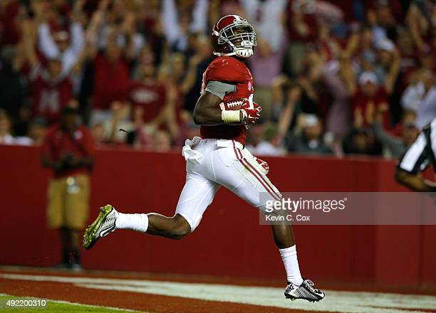 Calvin Ridley of the Alabama Crimson Tide takes this reception in for a touchdown against the Arkansas Razorbacks at BryantDenny Stadium on October...