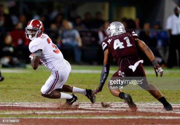 Calvin Ridley of the Alabama Crimson Tide tries to elude the tackle of Mark McLaurin of the Mississippi State Bulldogs after a reception during the...