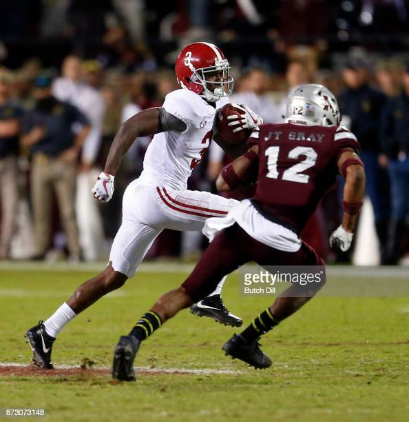 Calvin Ridley of the Alabama Crimson Tide tries to get around JT Gray of the Mississippi State Bulldogs after a reception for a first down during the...