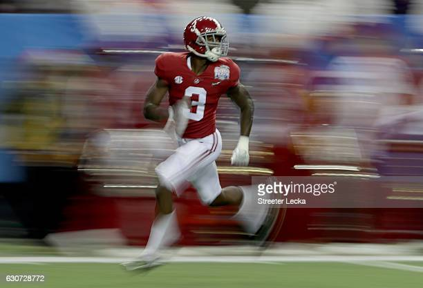 Calvin Ridley of the Alabama Crimson Tide warms up prior to the 2016 ChickfilA Peach Bowl against the Washington Huskies at the Georgia Dome on...