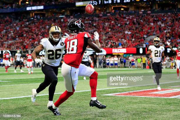 Calvin Ridley of the Atlanta Falcons catches a touchdown pass over PJ Williams of the New Orleans Saints during the first half at MercedesBenz...