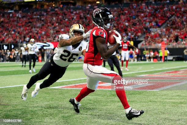 Calvin Ridley of the Atlanta Falcons catches a touchdown pass over P.J. Williams of the New Orleans Saints during the first half at Mercedes-Benz...