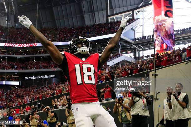 Calvin Ridley of the Atlanta Falcons celebrates a touchdown catch during the first half against the New Orleans Saints at Mercedes-Benz Stadium on...
