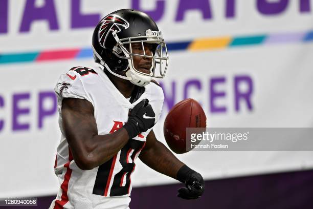 Calvin Ridley of the Atlanta Falcons celebrates after scoring a touchdown in the third quarter against the Minnesota Vikings at U.S. Bank Stadium on...