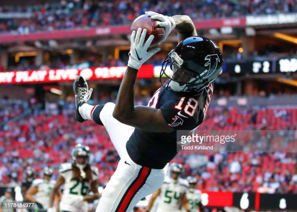 Calvin Ridley of the Atlanta Falcons converts a two point conversion with his reception in the second half of an NFL game against the Seattle...