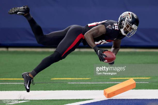 Calvin Ridley of the Atlanta Falcons dives across the goal line to score a touchdown against the the Dallas Cowboys in the first quarter at AT&T...