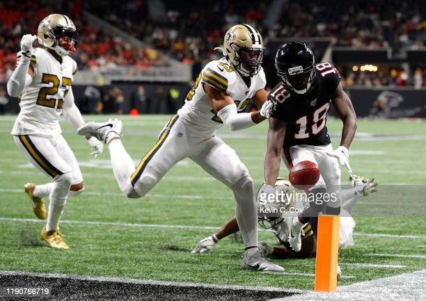 Calvin Ridley of the Atlanta Falcons drops the ball before crossing the pylon on a two-point conversion in the final minutes against Marcus Williams...