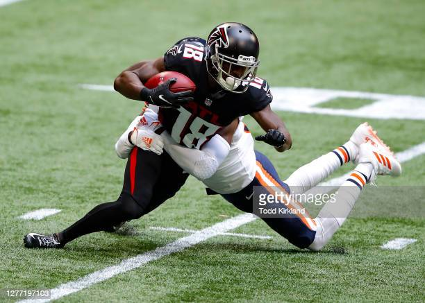 Calvin Ridley of the Atlanta Falcons is brought down by Eddie Jackson of the Chicago Bears during the second quarter of an NFL game at Mercedes-Benz...