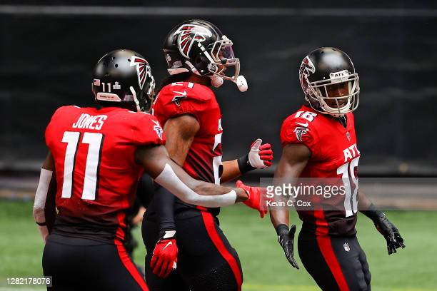 Calvin Ridley of the Atlanta Falcons is congratulated by Julio Jones and Todd Gurley II after catching a touchdown reception against the Detroit...