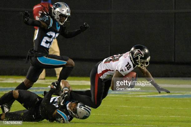 Calvin Ridley of the Atlanta Falcons is tackled by Jeremy Chinn of the Carolina Panthers during the second quarter at Bank of America Stadium on...