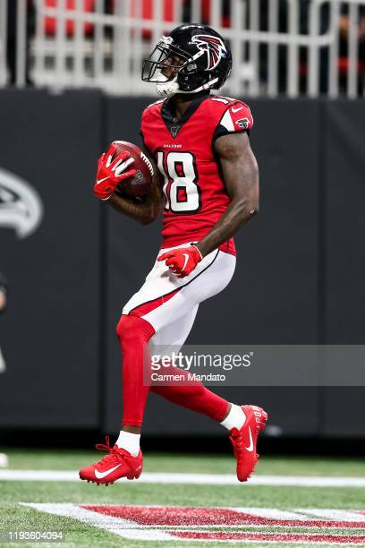 Calvin Ridley of the Atlanta Falcons reacts following a touchdown during the game against the Carolina Panthers at Mercedes-Benz Stadium on December...
