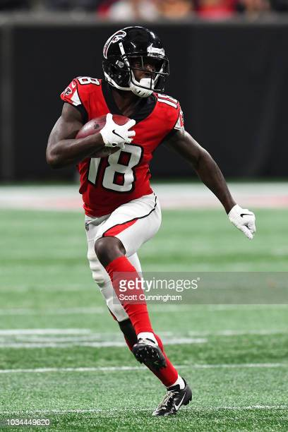 ATLANTA GA SEPTEMBER Calvin Ridley of the Atlanta Falcons runs after a catch during the second half against the Carolina Panthers at MercedesBenz...