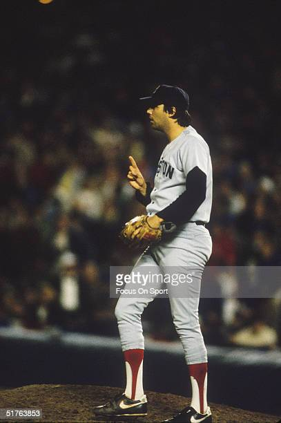 Calvin Schiraldi of the Boston Red Sox gestures to the infielders to remind them that therre is one out on the mound during the World Series against...
