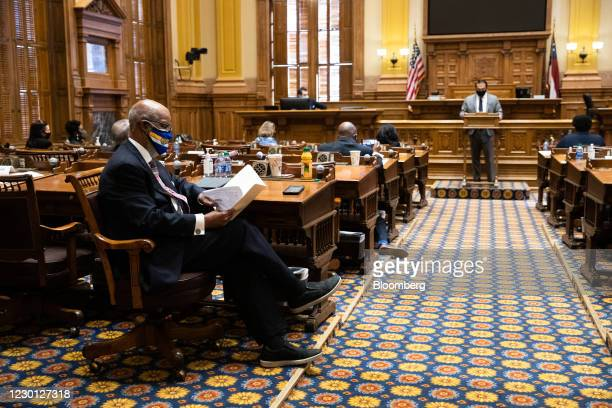 Calvin Smyre, Democratic state representative from Georgia, left, looks at a copy of the Certificate of Vote after members of the Electoral College...