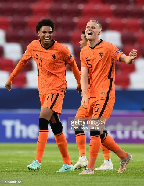 Calvin Stengs and Mitchel Bakker of Netherlands celebrates their side's victory after the 2021 UEFA European Under-21 Championship Quarter-finals...