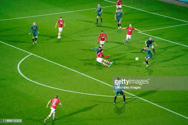Calvin Stengs of AZ Alkmaar shoots on goal during the Dutch Eredivisie match between AZ Alkmaar v Ajax at the AFAS Stadium on December 15, 2019 in...