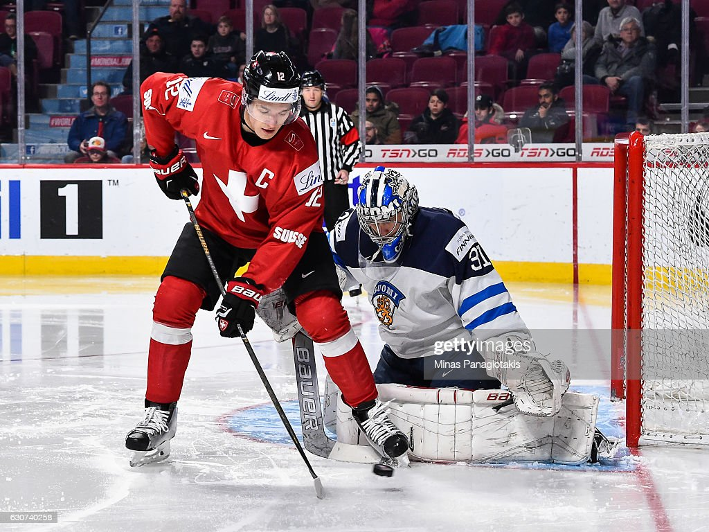 Calvin Thurkauf #12 of Team Switzerland tries to get a shot on goaltender Veini Vehvilainen #31 of Team Finland during the 2017 IIHF World Junior Championship preliminary round game at the Bell Centre on December 31, 2016 in Montreal, Quebec, Canada. Team Finland defeated Team Switzerland 2-0.