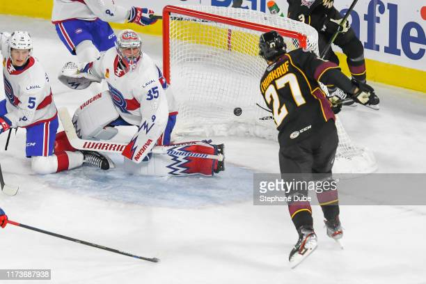 Calvin Thurkauf of the Cleveland Monsters scores his first goal of the season on Charlie Lindgren of the Laval Rocket at Place Bell on October 4,...
