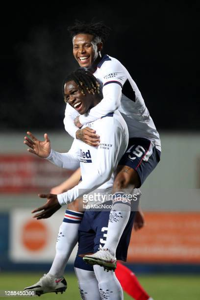 Calvin Ughelumba of Rangers celebrates with Bongani Zungu after scoring their team's second goal during the Betfred Cup match between Falkirk and...
