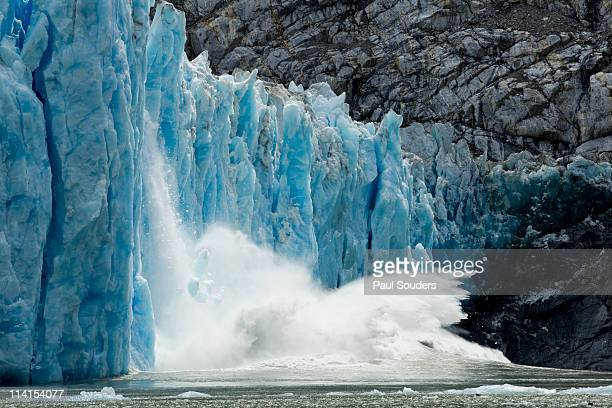 calving dawes glacier, alaska - collapsing stock pictures, royalty-free photos & images