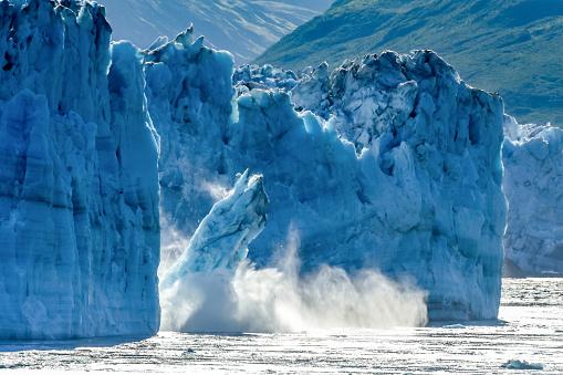 Calving Glacier Alaska - Hubbard Glacier - a huge iceberg calves into Disenchantment Bay - St. Elias Alaska. Taken from an Alaska cruise ship - near Yukon, Canada 1061549950