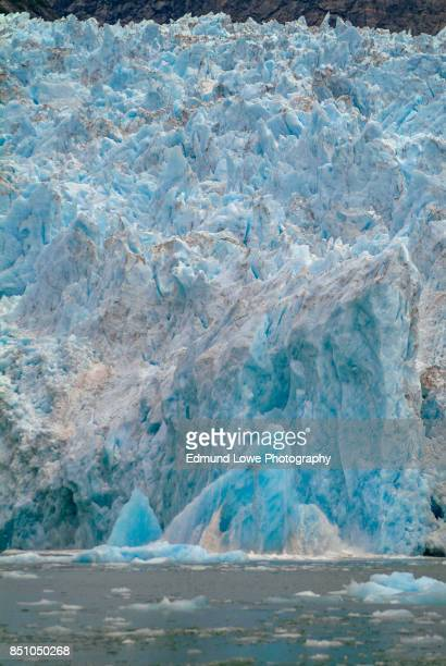 calving ice on the leconte glacier. - glacier collapsing stock pictures, royalty-free photos & images
