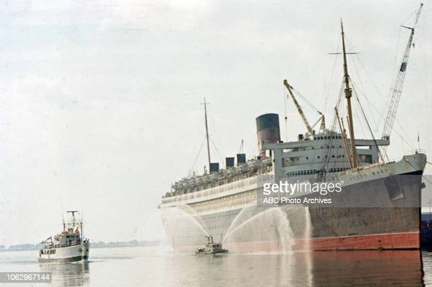 RV Calypso in harbor with RMS Queen Mary in the background on 'The Undersea World of Jacques Cousteau'