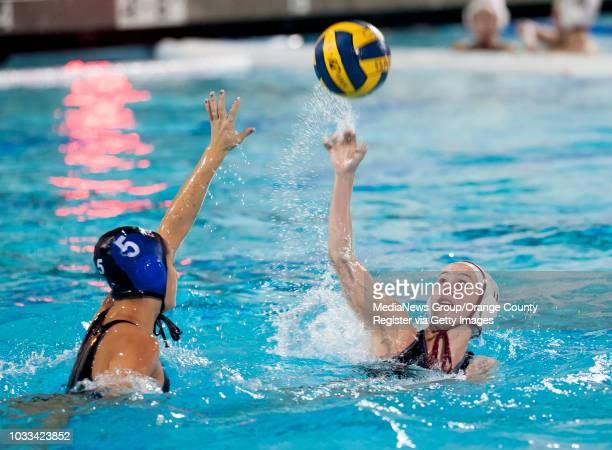 Calysa Toledo left of Los Alamitos attempts to block the pass of Alana Evans of Laguna Beach during a nonleague girls water polo game at Santa Ana...
