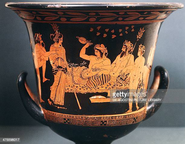 Calyx krater depicting a scene of symposium with Hephaestus and Dionysus raising a cup redfigure pottery from the Valley of the Temples in Agrigento...