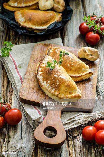 Calzone stuffed with tomatoes and sage