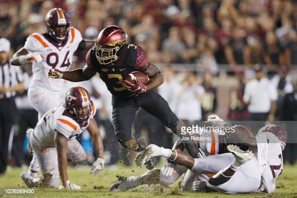 Cam Akers of the Florida State Seminoles gets tackled for a loss of yardage in the second quarter of the game against the Virginia Tech Hokies at...