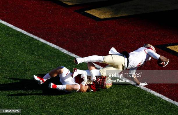 Cam Akers of the Florida State Seminoles reachesout to score a touchdown during the third quarter of the game against the Boston College Eagles at...