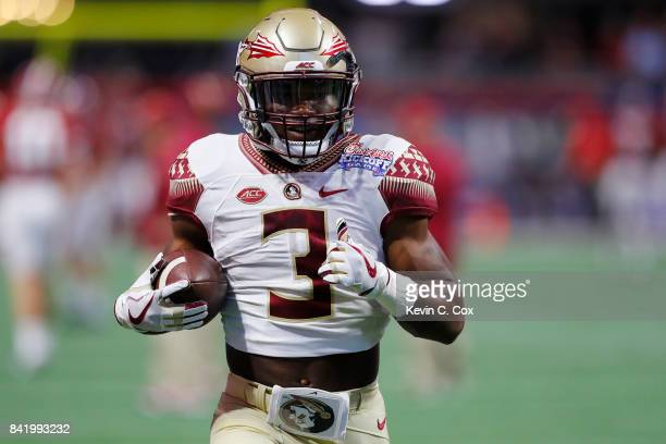 Cam Akers of the Florida State Seminoles warms up prior to their game against the Alabama Crimson Tide at MercedesBenz Stadium on September 2 2017 in...