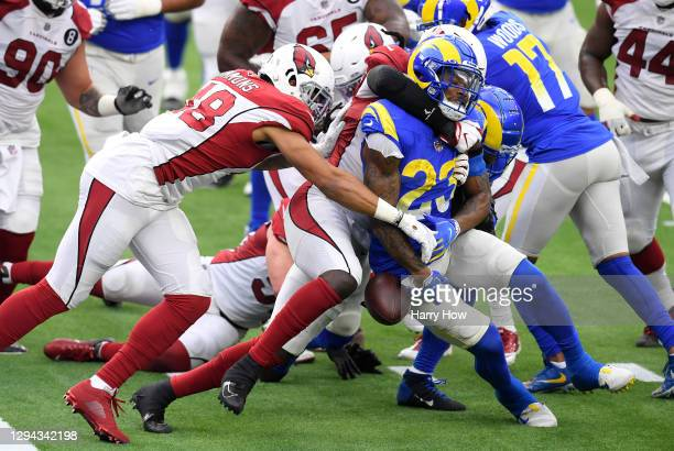 Cam Akers of the Los Angeles Rams fumbles the ball at the goal line as he is tackled by De'Vondre Campbell and Isaiah Simmons of the Arizona...
