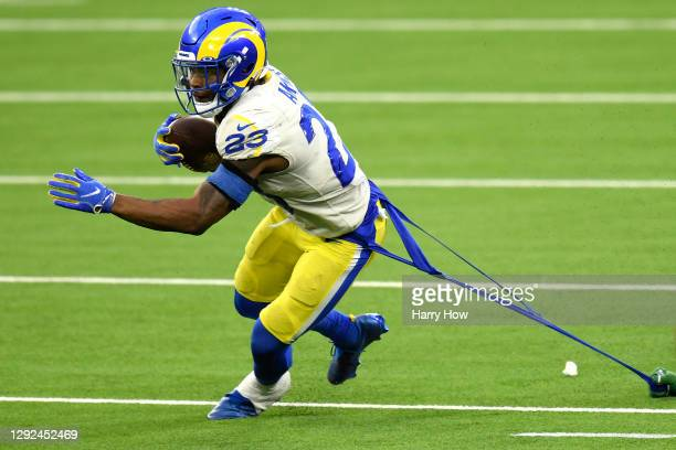 Cam Akers of the Los Angeles Rams has his uniform pulled during the fourth quarter of a game against the New York Jets at SoFi Stadium on December...