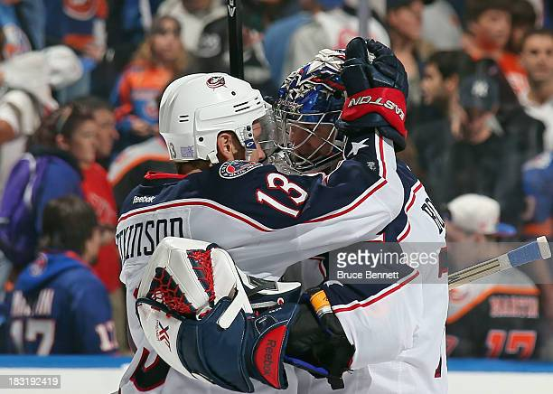 Cam Atkinson and Sergei Bobrovsky of the Columbus Blue Jackets embrace following Atkinson's shootout winning goal against the New York Islanders at...