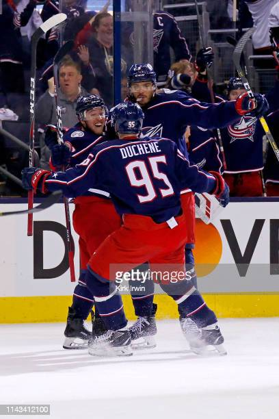 Cam Atkinson of the Columbus Blue Jackets and Matt Duchene congratulate Seth Jones after scoring a goal in Game Four of the Eastern Conference First...